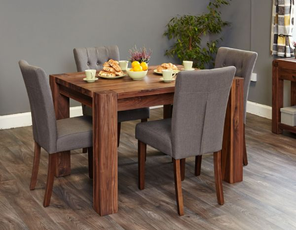 Shiro small solid walnut fixed top dining table to seat up to four.